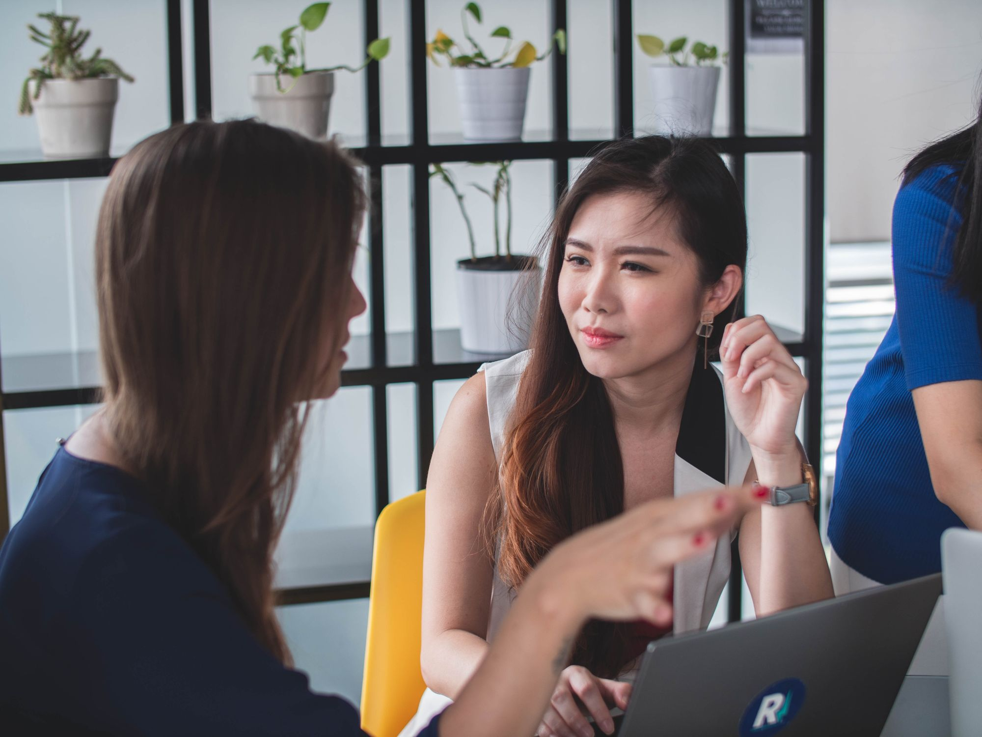 woman listening to another woman talking at work